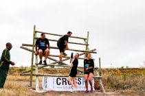 One of the teams at the Grahamstown Games going over an obstacle while tackling the obstacle course section of the games