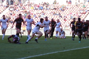 Angus Curtis runs towards the line for Ulster's third try against the Kings on the stroke of full time.