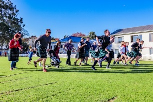 The first annual Kilted Mile run at St Andrew's College gets underway, with students and family members getting off to a good start.