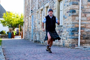 Graeme Holmes runs past the St Andrew's Chapel showing more thigh than expected through his kilt.