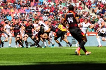 Ulster's Stuart McCloskey charges forward into resolute Kings defence.
