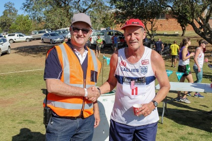 GBS Mutual Bank's Anton Vorster congratulates Comrades Marathon legend, Alan Robb, on finishing the GBS Mountain Drive Half Marathon