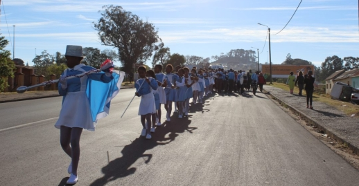 The Archie Mbolekwa Drum Majorettes lead the procession of women in the walk towards Fort England on Thursday 9 August from Fingo Square.