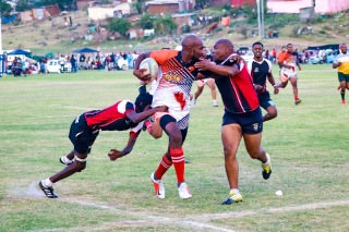 The Ghost Town Lions clashes with the Tyantyi Rangers in their semi final to reach their third consecutive final. Photo: Stephen Kisbey-Green