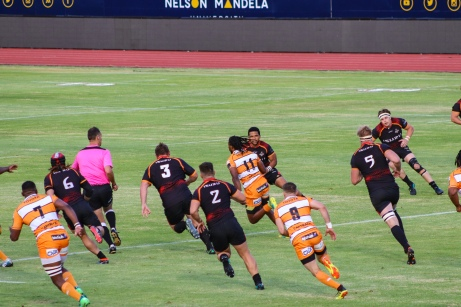 The Cheetahs opening try scorer, Rabz Maxwane, shreds his way through the Kings' defensive line, moments before scoring the opening try of the game. Photo: Stephen Kisbey-Green