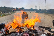 The residents of the Sun City informal settlement took to the streets in protest of a lack of follow-through from the municipality, burning rubbish and their uncollected bucket toilets on Tuesday 12 February. Photo: Stephen Kisbey-Green