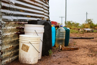 The residents of the Avondale area have to rely on rainwater for the majority of the year, with their only other source of water coming from a borehole a number of kilometers away, down a steep hillside. Photo: Stephen Kisbey-Green