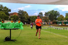Stephen Penney crosses the finish line of the Makana Brick Nite Race. Photom Stephen Kisbey-Green