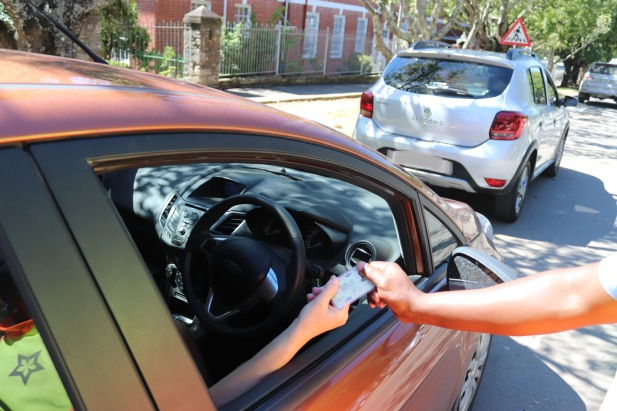A traffic officer checks a motorist's driver's license in Makhanda (Grahamstown). Photo: Stephen Kisbey-Green