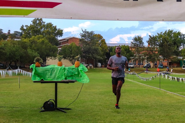 The overall winner of the Makana Brick Nite race, Lubabalo Bokuva, crossing the finish line on Wednesday 6 March. Photo: Stephen Kisbey-Green