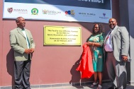 The Executive Mayor of Makana, Mzukise Mphahlwa (left) along with the MEC for Sport, Recreation, Arts and Culture, Bulelwa Tunyiswa (middle) and the President of the Eastern Cape Sports Council, Mkhulili Magada (right) display the plaque displayed outside the Saarah Baartman District Academy of Sport building in Joza at its official opening. Photo: Stephen Kisbey-Green