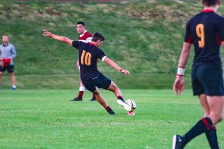 Kingswood's flyhalf slots a penalty kick while his scrum half looks on. Photo: Stephen Kisbey-Green