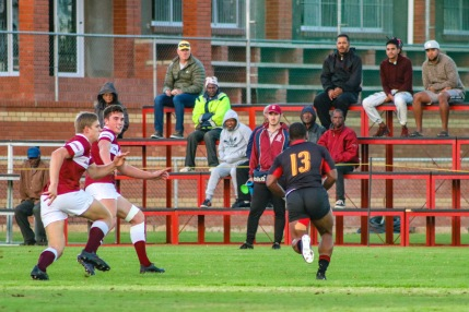 Kingswood's outside Centre lines up two Kearsney defenders on another powerful run. Photo: Stephen Kisbey-Green
