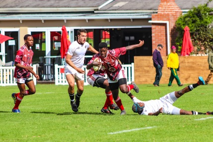 The winger from St George's (Zimbabwe) runs over one Hilton's defenders on his way up the touch line. Photo: Stephen Kisbey-Green