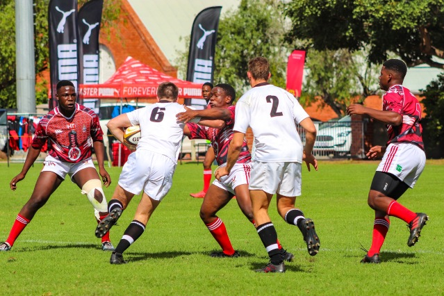 St George's (Zimbabwe) attempt to stop the Hilton attack on day one of the Kingswood College 125 First Team Rugby Festival. Photo: Stephen Kisbey-Green