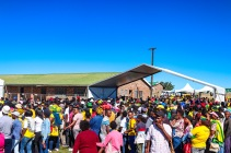 There seemed to be more people queuing up to receive food packages outside the tent than there were inside celebrating with the choir during the 2019 Freedom Day Celebrations at Miki Yili Stadium. Photo: Stephen Kisbey-Green