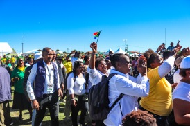 Members of the public sing and wave flags in celebration of the 2019 Freedom Day programme at Miki Yilli Stadium. Photo: Stephen Kisbey-Green