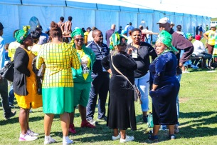 A group of supporters, dressed in ANC regalia, gathered outside the tent at Miki Yili. Photo: Stephen Kisbey-Green