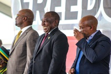 President Cyril Ramaphosa laughs at a joke that was told on stage, while Premier Phumulo Masualle (right) and Minister Nathi Mthethwa (left) look on. Photo: Stephen Kisbey-Green