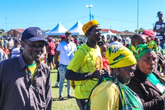 Members of the Makhanda community, some dressed in ANC Regalia and Colours, walk into the tent where the President, hail Ramaphosa, had just finished his address. Photo: Stephen Kisbey-Green