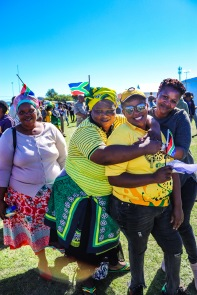 Supporters dressed in ANC regalia and colours were all smiles after seeing the South African President, Cyril Ramaphosa live at Miki Yili. Photo: Stephen Kisbey-Green