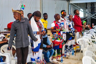 performers in their traditional dress ready to listen to the presidential address. Photo: Stephen Kisbey-Green