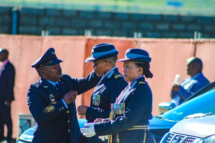 A senior military official helps the guard of honour prepare for their role escorting the President, Cyril Ramaphosa. Photo: Stephen Kisbey-Green