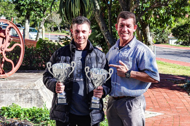 Francois Botha (left), who came second in the U23 Junior category as well as the 80kg senior category of the 2019 IBFF Mr Universe completion, alongside his proud father, Johan Botha with his two trophies. Photo: Stephen Kisbey-Green