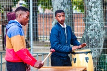 A group of young marimba players entertains the crowds walking through the Village Green. Photo: Stephen Kisbey-Green