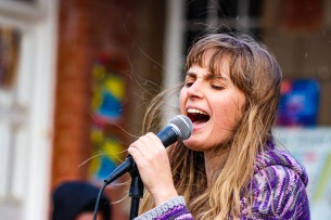 Rain, wind and cold didn't stop the passionate and talented buskers at the Village Green, as evident by the lead singer of this band. Photo: Stephen Kisbey-Green