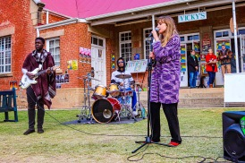 As the rain began to fall, this young local band began their set near the food stalls at the Village Green. Photo: Stephen Kisbey-Green