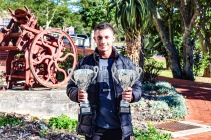 Francois Botha, who came second in the U23 Junior category as well as the 80kg Senior category of the 2019 IBFF Mr Universe completion, with his two trophies. Photo: Stephen Kisbey-Green