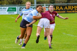 Eimear Corri bursts through a tackle on the wing. Photo: Stephen Kisbey-Green