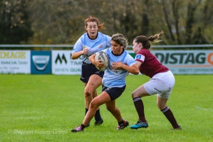 Zoe Valentine attempts to run around the Tullow RFC defence. Photo: Stephen Kisbey-Green