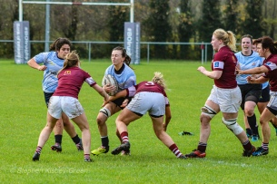 Sophie Kilburn is stopped in a massive tackle. Photo: Stephen Kisbey-Green