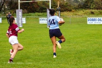 Eimear Corri on her way to scoring the first of her three tries. Photo: Stephen Kisbey-Green