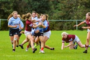 Kirara Kirasha fighting through a group tackle. Photo: Stephen Kisbey-Green