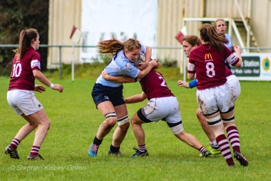 Nikki Gibson makes a strong carry into the Tullow defenders. Photo: Stephen Kisbey-Green