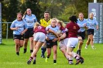Jane Waters takes a big hit after a sniping run from the base of the ruck. Photo: Stephen Kisbey-Green