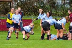 Leah Reilly clears the ball out from the back of the ruck. Photo: Stephen Kisbey-Green