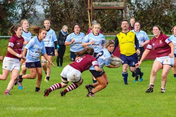 Zoe Valentine looks to offload in the tackle. Photo: Stephen Kisbey-Green