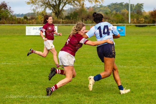 Eimear Corri brushes off a strong tackle attempt en route to the tryline. Photo: Stephen Kisbey-Green