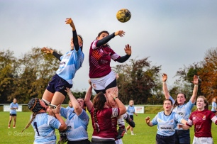 Claire Kealy and Katie O'Brien lift Sophie Kilburn as she reaches across the lineout for the ball. Photo: Stephen Kisbey-Green