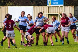 Kate Jordan fights through the tackle. Photo: Stephen Kisbey-Green
