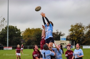 DCU's Claire Kealy and Katie O'Brien lift Sophie Kilburn in the lineout, while Kate Fox watches on. Photo: Stephen Kisbey-Green