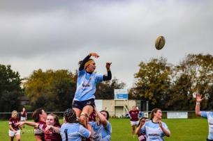 Sophie Kilburn looks back as the ball flies overhead. Photo: Stephen Kisbey-Green
