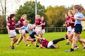 Jane Waters fights to get through the tackle. Photo: Stephen Kisbey-Green