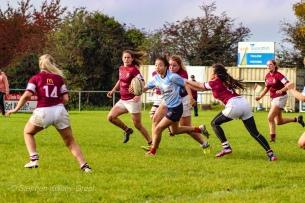 Kirara Kirasha looks to offload the ball through the tackle. Photo: Stephen Kisbey-Green