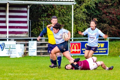 Casey O'Brien looks to free herself from the tackle. Photo: Stephen Kisbey-Green