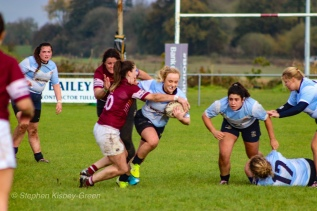 Jane Waters fights hard to get through the tackle as Casey O'Brien and Kate Jordan watch on in anticipation for what's next. Photo: Stephen Kisbey-Green